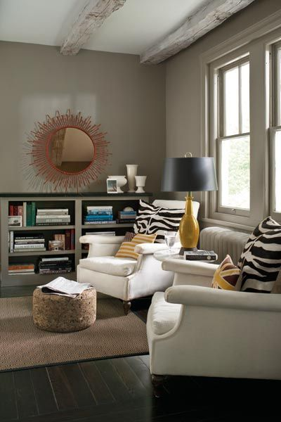 Lively accents like zebra-print pillows and a sunburst mirror, show how this neutral can gracefully balance a rainbow of hues. | Sparrow AF-720, Aura in Matte finish, @benjamin_moore: Wall Colors, Colors Trends, Living Rooms, Paintings Colors, Reading Nooks, Paint Colors, Benjamin Moore Sparrow, Cozy Reading, Color Trends