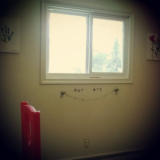 Add a photo hanger to the playroom to hang art projects up to dry !