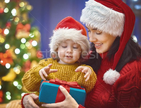 Mother and daughter exchanging gifts stock photo (c) choreograph (#8555060) | Stockfresh