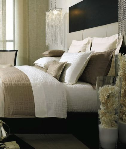 Kelly Hoppen Interiors - bedrooms - decorative coral, coral in vases, white and tan bedding, silk duvet,  Tufted upholstered leather headboa...
