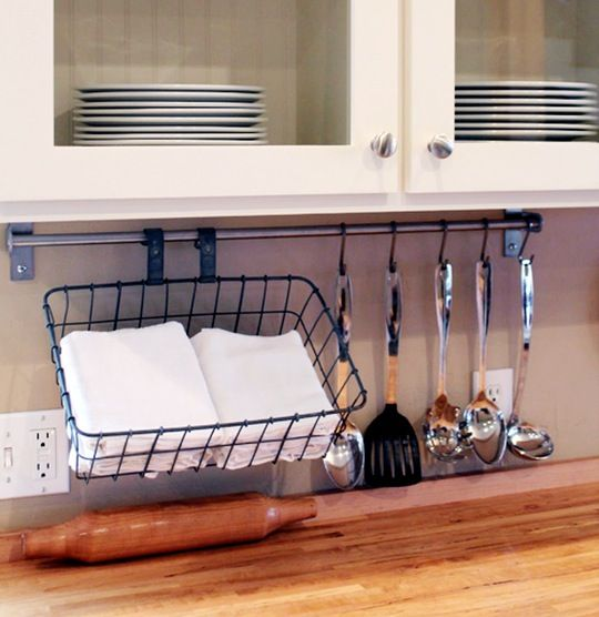 We've said it before: keeping kitchen linens in a basket is a nice, neat storage solution. But this idea takes it one step forward: make that basket a vintage bicycle basket, and hang it from a rod (like IKEA's Grundtal rail) on your backsplash!