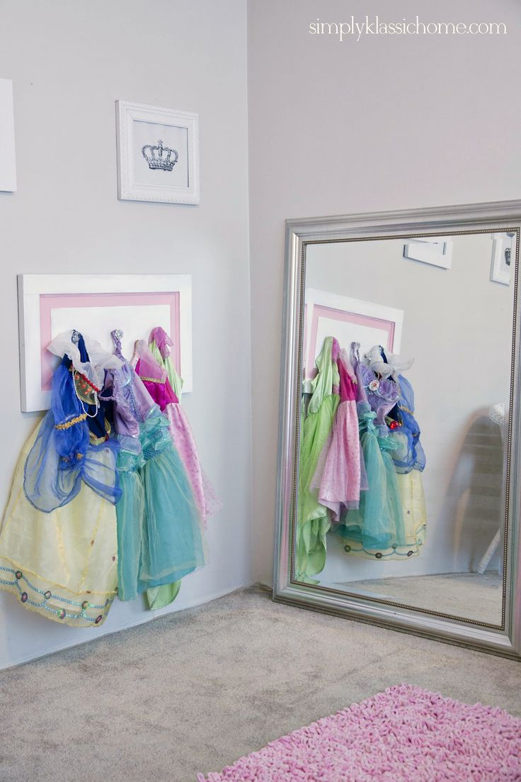 Simply Klassic Home: Little Girl's Princess Room Makeover Reveal-the hanging bit would be easy to make and would look cute with the costumes or even coats and scarves hung on it