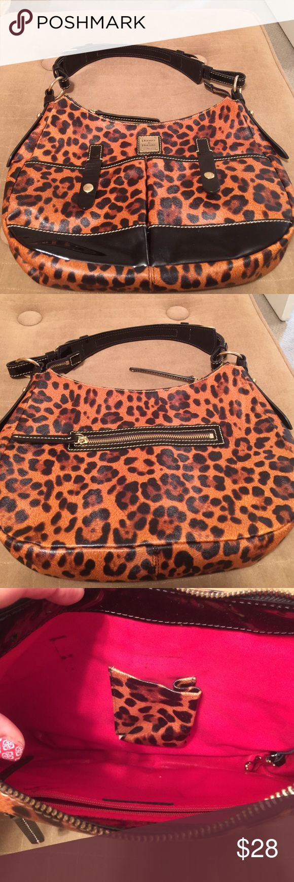 Dooney and Bourke Animal print shoulder bag This bag is a rubber fabrication. It has a few stains only on the pink lining. Dooney & Bourke Bags Shoulder Bags