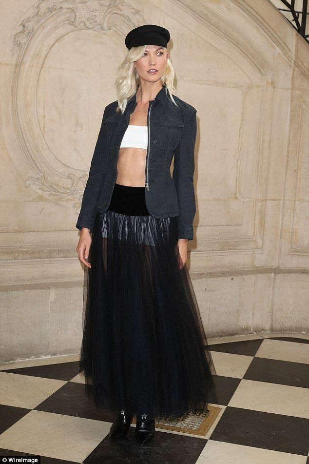 Model mayhem: Karlie stole the limelight in a semi-sheer navy tulle skirt that flashed her white undergarments at the Alberta Ferretti SS18 catwalk show during Milan Fashion Week on Monday night