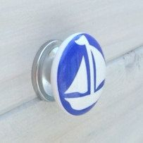 A personal favorite from my Etsy shop https://www.etsy.com/listing/464718722/sailboat-knob-white-and-blue-round