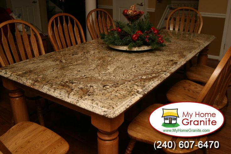 Beautiful granite dining table with an awesome rotating for Rotating dining table