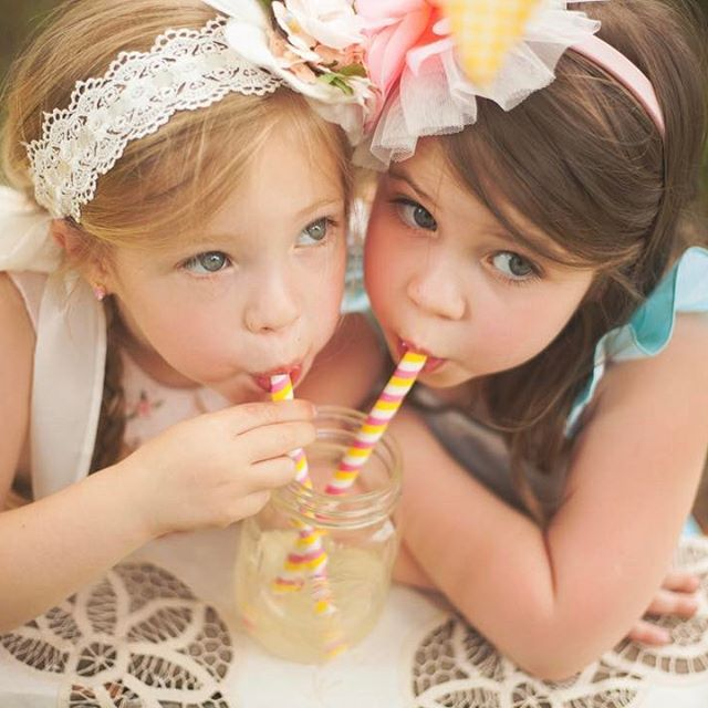 Twins drinking lemonade for a country feel in this spring family photography shoot. These girls are actually twins!     © Kasey Keown Photography | @KaseyKeown