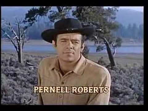 """Bonanza"" Theme Song. ""Deputy Davis stops walking and rests one hand on his billy club, and one on his holster, like he's Hoss Cartwright and we're threatening the Ponderosa."""