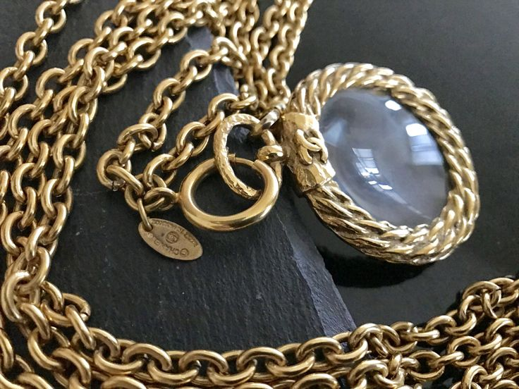 Chanel necklace, Chanel CC gold necklace,  Vintage chanel magnifying necklace, Authentic Chanel necklace, Chanel magnifying glass pendant by NUKOBRANDS on Etsy https://www.etsy.com/listing/515375157/chanel-necklace-chanel-cc-gold-necklace