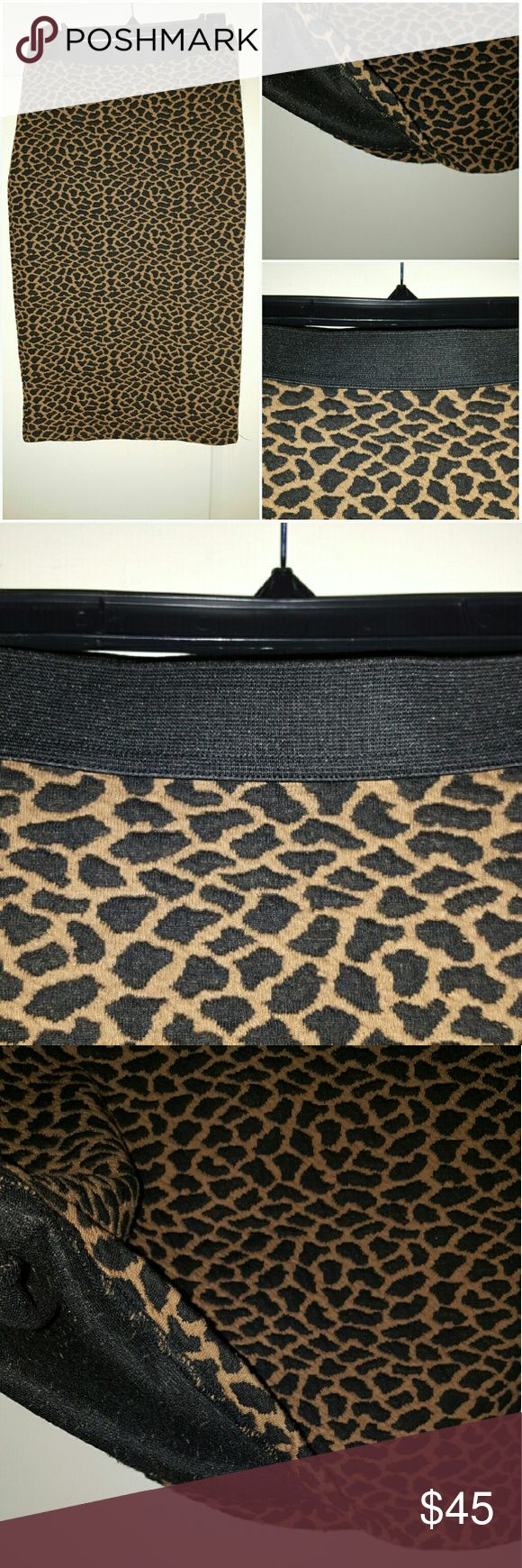 Leopard Pencil Skirt Slimming look of a stretch-knit pencil skirt patterned in a leopard graphic. Skirts Pencil