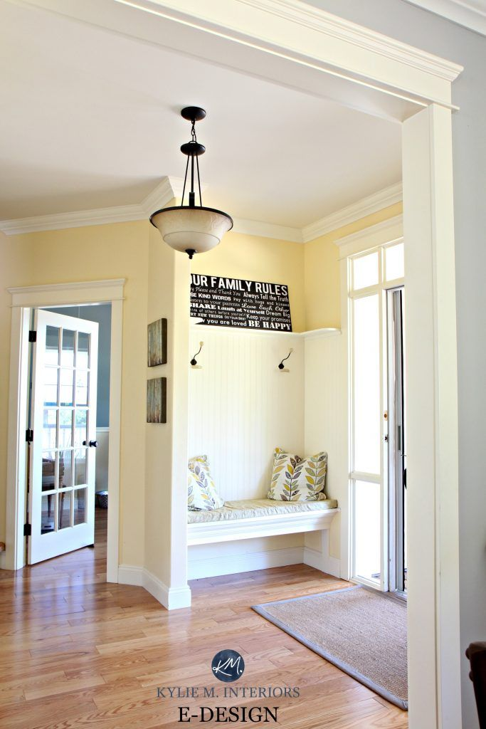 Best yellow paint colour. Benjamin Moore Buttermilk. Oak flooring. country style foyer, entryway with built in bench and hooks. Kylie M E-design, online colour consultant