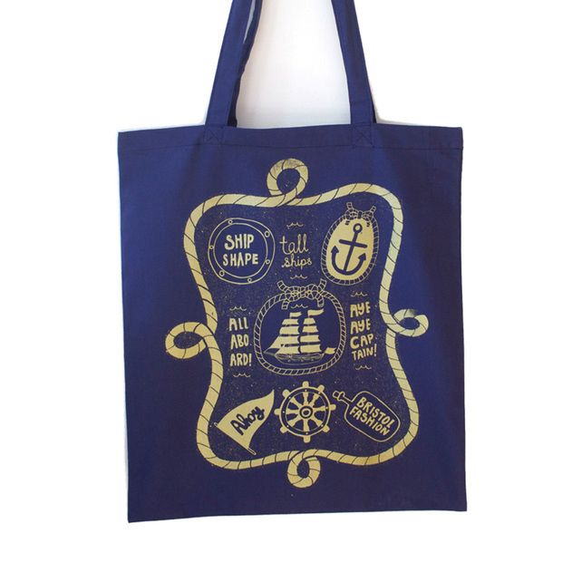 Fun typography pirate phrases accessory. Ship shape nautical navy blue and gold tote bag  £8.00