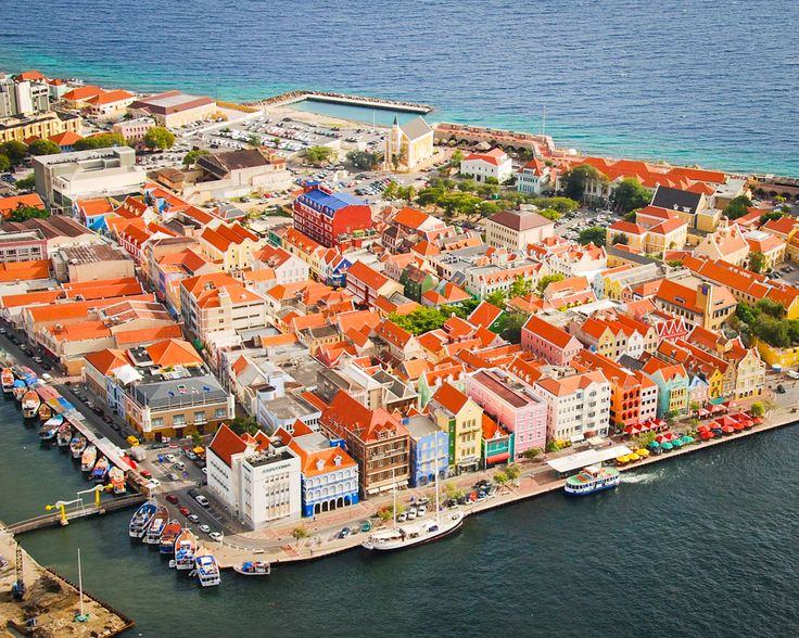 Curaçao, Dutch Caribbean  The capital Willemstad has gorgeous architecture in its historic centre and the buildings on the dock there are protected and on the Unesco World Heritage List.