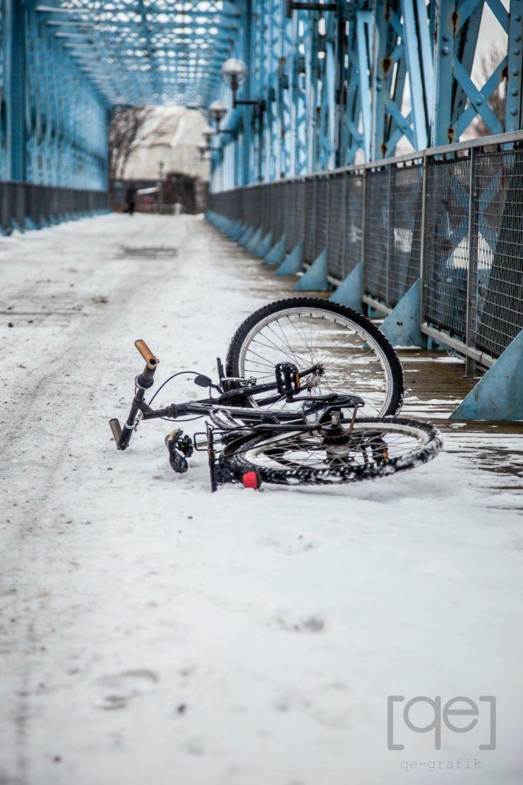 Snowy day in Denmark, bicykle on a bridge  - Photograph by Qe-grafik