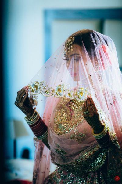 Bridal Details - Bride in a Pink and Gold Lehenga with Net Dupatta as Veil   WedMeGood #wedmegood #indianbride #indianwedding #bridal #pink #net #gold #Lehenga #veil #sikhbride
