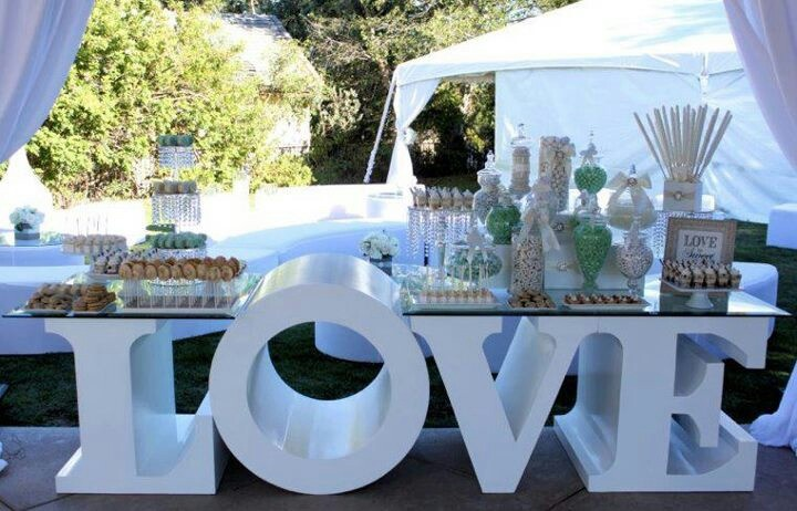 This table is AWESOME for a dessert bar at a wedding reception!!