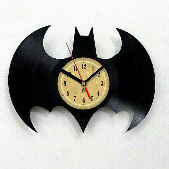 Cut vinyl record in the shape of Batman logo & insert mechanical clock in the center. Will make a unique gift for any Batman fan. G;)