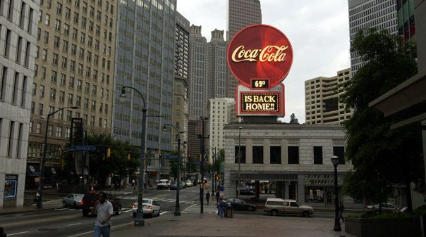 On May 6, 2003, several hundred people gathered in the rain to witness the lighting of an Atlanta landmark -- the return of a Coca-Cola neon sign to downtown Atlanta after an absence of more than 20 years. Just two days before the Company's 117th birthday, Doug Daft, chairman of The Coca-Cola Company, Lowry Kline, chairman of bottler Coca-Cola Enterprises, Georgia Governor Sonny Perdue, and Atlanta Mayor Shirley Franklin lit a retro version of the famous landmark.