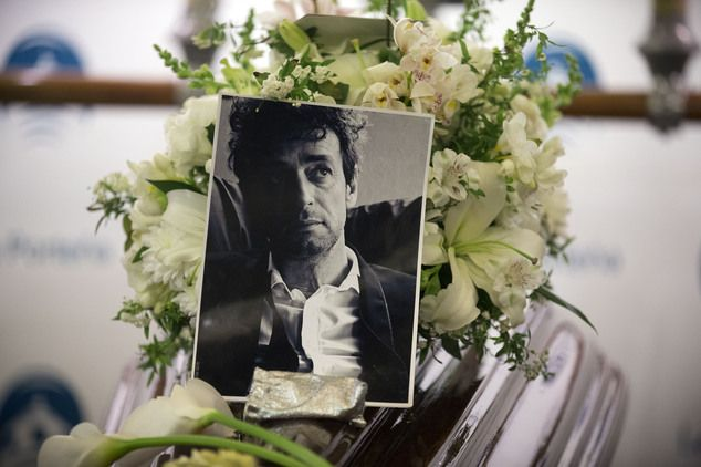 A photo of Argentine rock star Gustavo Cerati sits atop the coffin containing his body at the Buenos Aires City's Legislature, Argentina, Thursday, Sept. 4, ...