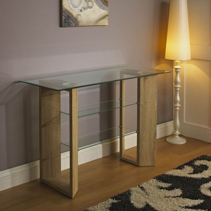Golf Console Table. 8mm tempered glass table top with 6mm frosted glass shelf and oak veneer pedestal.     Item Dimensions: H: 82 cm L: 120 cm W: 50 cm    SKU : GOLFCONSOLEDS