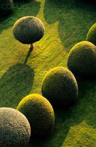 Topiary garden in Gourdon Village, one of Les Plus Beaux Villages de France (The Most Beautiful Villages of France). The bushes in the garden were designed by Andre Le Notre. © Sylvain Safra/ Hemis/Corbis
