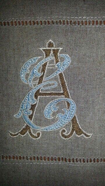 Custom Designed Monogram by Allison R. Banks. Embroidered onto cocktail napkin.