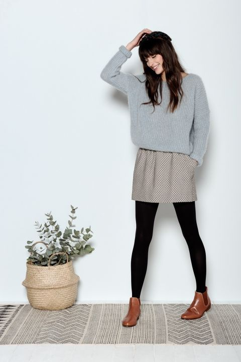 Cute and casual neutrals outfit with the grey sweater, neutral skirt, black tights, and brown ankle boots