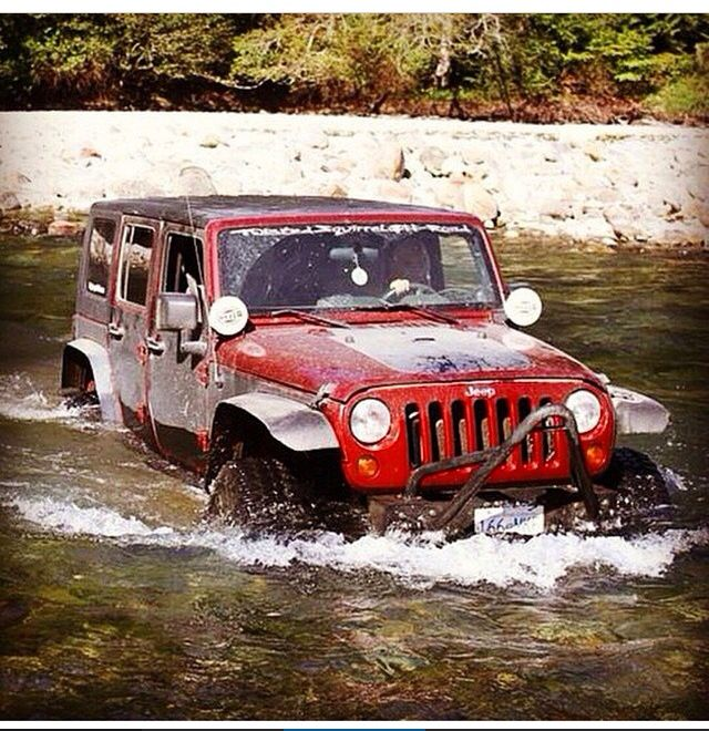 RED JEEP JK GOING THRUNWATER
