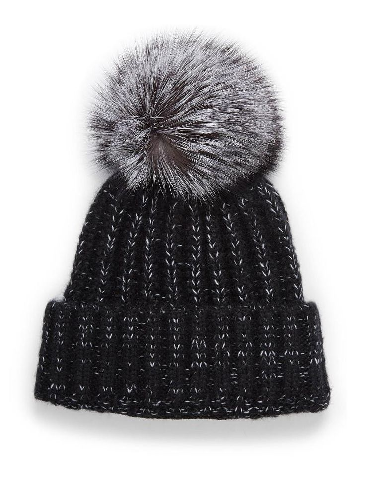 Tailored to guard against the frigid Canadian winters, fashion label Kyi Kyi's beanie line is sure to be a popular hit for the yuletide season's online shopping blitz.  / Made with pizazz, and high quality materials, the stylish pom pom topped, fleece-lined beanies keep heads and ears cozily warm amid...