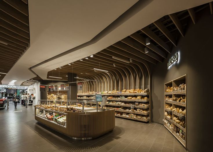Dutch supermarket Spar's flagship store in Budapest features a series of undulating wooden forms through its interior by local firm LAB5 architects.