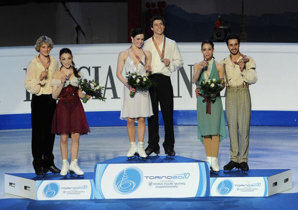 Charlie White Tessa Virtue Photos - The Silver medalist Meryl Davis and Charlie White of USA, the Gold medalist Tessa Virtue and Scott Moir of Canada and the Bronze medalist Federica Faiella and Massimo Scali of Italy pose on the Podium after the Ice Dance Free Dance at the 2010 ISU World Figure Skating Championshipson March 26, 2010 in Turin, Italy. - ISU World Figure Skating Championships - Day Four