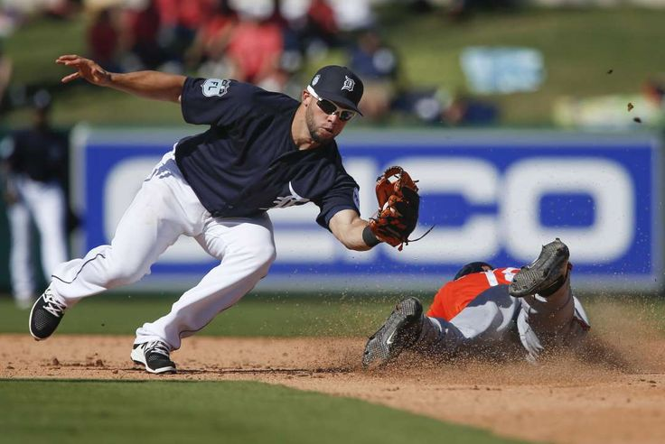 2017 spring training:     Sliding in safe:    Chris Dickerson, right, of the Baltimore Orioles is safe before Juan Perez of the Detroit Tigers can apply the tag during the fifth inning of a  spring training game at Joker Marchant Stadium in Lakeland, Fla., on Feb. 24. The Orioles won 2‐0.