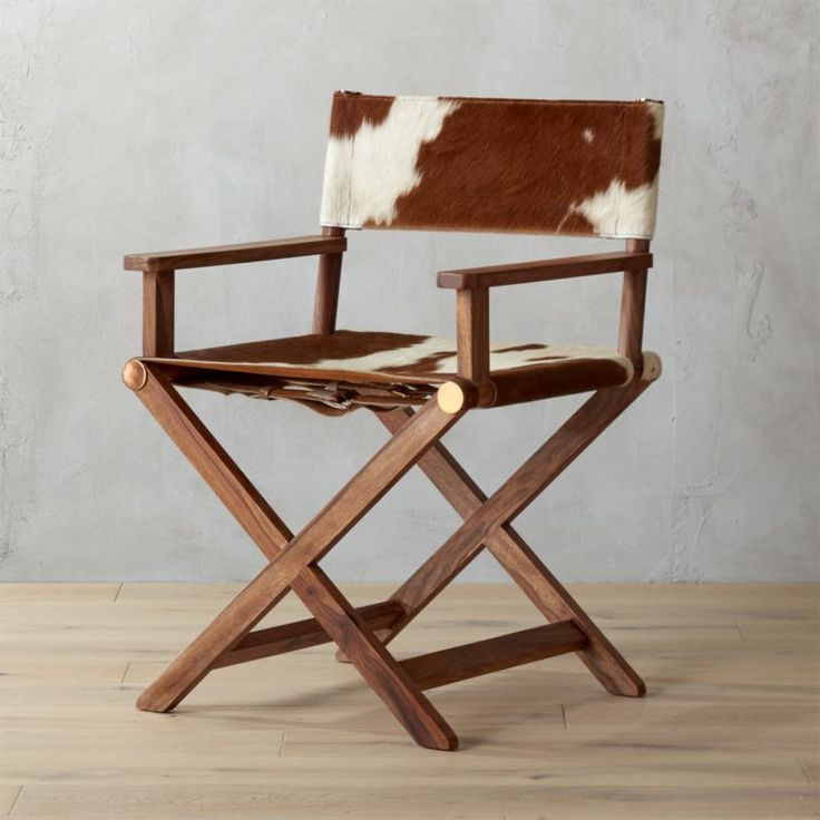 Shop curator cowhide director's chair.   From a Hollywood movie set to home sweet home.