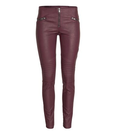 Low-rise burgundy leggings in stretchy imitation leather. Quilted details on knees, mock pockets with decorative zips, and visible zip at front.  | H&M Divided