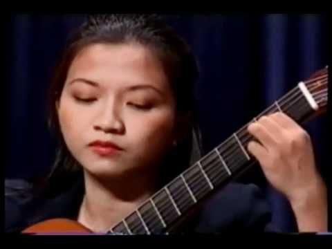 Beautiful rendition of Recuerdos de la Alhambra by Kim Chung.  so smooth. Damn, you can hardly see her fingers moving yet the tremolo is perfect.
