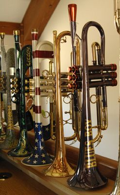 A collection of trumpets made by  Andy Taylor on display in Joe Utley's home in South Carolina.