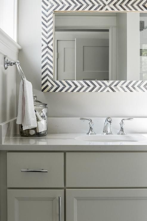 Exquisite Gray And White Bathroom Features A Gray Bath Vanity Fitted With  Polished Nickel Pulls And A White Quartz Countertop Finished With An Oval  Sink ...