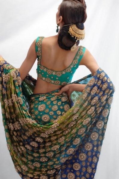 Lush...both blouse, sari, and weight of embroidery