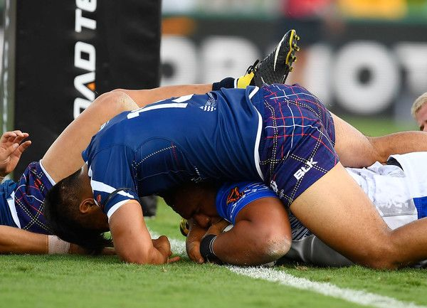 Junior Paulo of Samoa scores a try during the 2017 Rugby League World Cup match between Samoa and Scotland at Barlow Park on November 11, 2017 in Cairns, Australia.