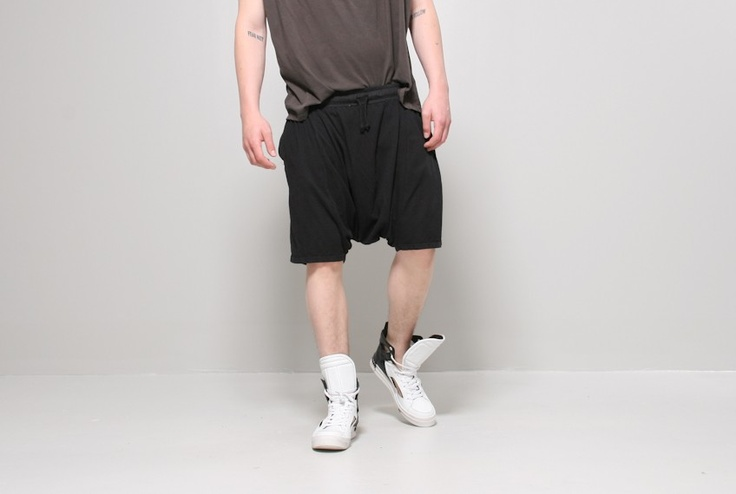 dhoti short black - Dhoti short in black by Oak. Elastic waist drawstring shorts with dropped crotch and side pockets. Unisex  Model wears size L. 14W x 18L  100% cotton  Made in the U.S.A.