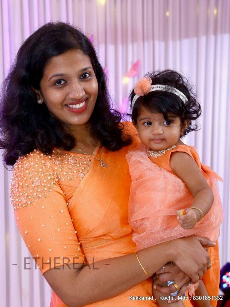 Prints and her little princess in matching Ethereal outfits  #etherealkochi #ethereal #momandbabymatchingoutfits #momandbaby #embroidery #pearls #hairbows #babydress