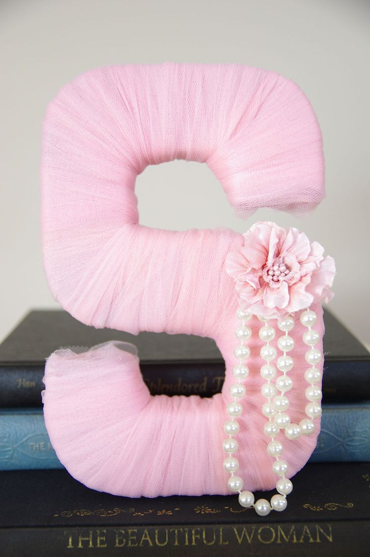 Tulle wrapped letter: cardboard letter wrapped in tulle. Hot glue pearls on and embellishment