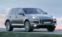 Porsche Cayenne - Another school   -run hedgie wanker mobile. Big, vulgar, ugly and clumsy. Whatever happened to Porsche's taste?