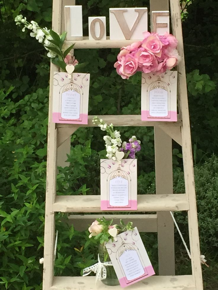 Vintage table plan ladder for a vintage wedding with printed and personalised table plan cards.