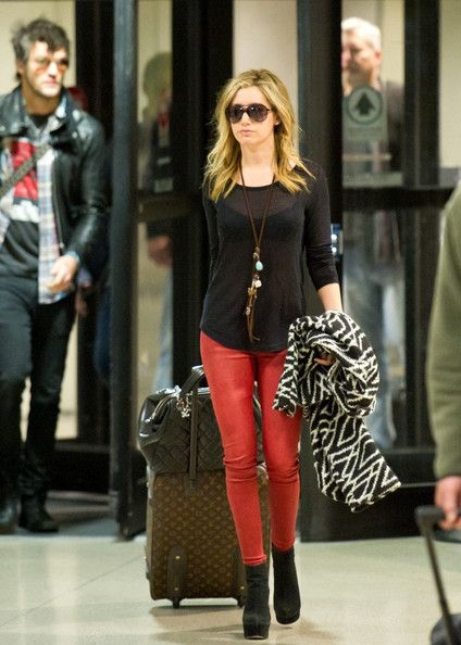 Awesome outfit! ...sheer tee with hot red leather pants and geo-pattern coat!