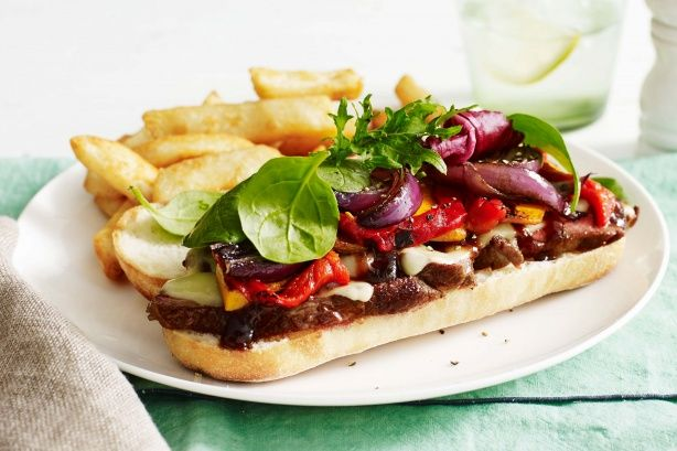 Create the ultimate pub sandwich with this sensational steak and cheese sandwich served with crunchy beer-battered chips.