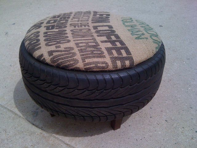 used burlap and tire ottomans. removable lid for storage. materials: re-purposed tire, wooden legs, re-purposed coffee sacks, plywood.
