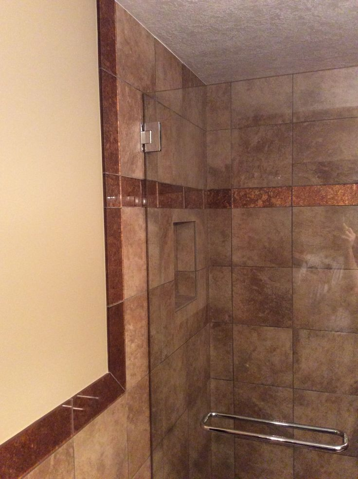 Photos On Custom bathroom remodel with tiled shower and copper trim and frameless glass