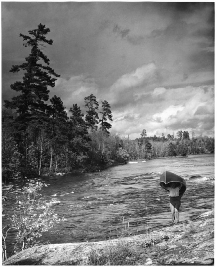 Portaging at Basswood Lake circa 1955 #classicbwca. ( : Donald Holmquist) .  . . . . . . . . . . . #bwca #bwcaw #boundarywaters #boundarywaterswilderness #boundarywaterscanoearea #tbt #throwback #throwbackthursday #humbleapparelco #humbleapparel #mnoutdoors #getoutdoors #outdoors #paddle #instamn #instaminnesota #minnesota #canoe #canoeing #leavenotrace #onlyinmn #portage #lakelife #outdoorlife #retro #oldminnesota #oldbwca #1955 #basswoodlake
