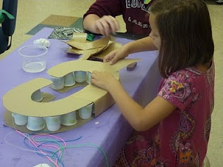 Excellent idea! Using disposable cups as a support in sculpture building